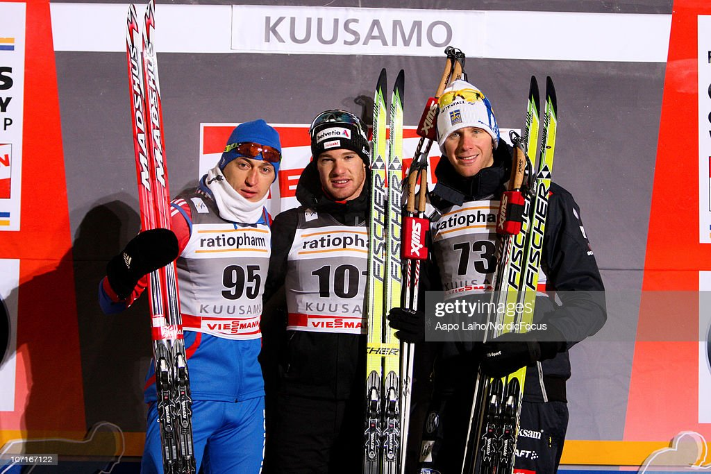 Alexander Legkov of Russia, <a gi-track='captionPersonalityLinkClicked' href=/galleries/search?phrase=Dario+Cologna&family=editorial&specificpeople=4779620 ng-click='$event.stopPropagation()'>Dario Cologna</a> of Switzerland and <a gi-track='captionPersonalityLinkClicked' href=/galleries/search?phrase=Daniel+Rickardsson&family=editorial&specificpeople=4907512 ng-click='$event.stopPropagation()'>Daniel Rickardsson</a> of Sweden (L-R) pose on the podium of men individual 10km classic Cross Country Skiing during the FIS World Cup on November 27, 2010, in Kuusamo, Finland.