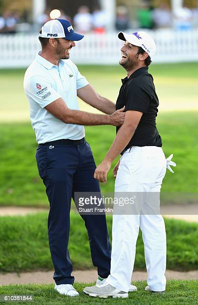 Alexander Levy of France celebrates victory with Gregory Havret of France in the final round of the Porsche European Open at Golf Resort Bad...