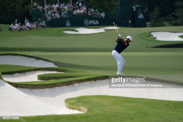 Alexander Levy of France hits his shot on the seventh hole during Round Two for the 99th PGA Championship held at Quail Hollow Club on August 11 2017...