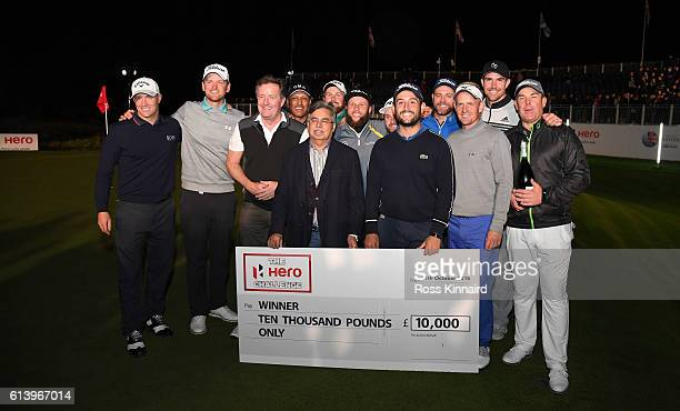 Alexander Levy of France is presented with the winners cheque by Mr Pawan Munjai after wining the 'Hero Challenge' prior to the British Masters at...