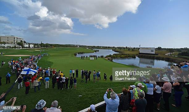 Alexander Levy of France is presented with the winners trophy on the 18th green after the cancellation of the final round of the Portugal Masters at...
