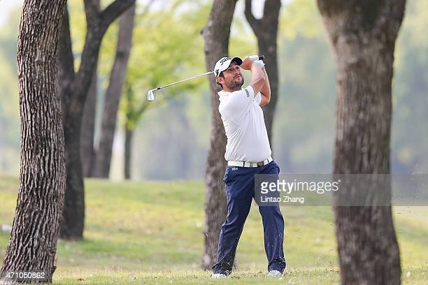 Alexander Levy of France plays a shot during the day three of the Volvo China Open at Tomson Shanghai Pudong Golf Club on April 25 2015 in Shanghai...