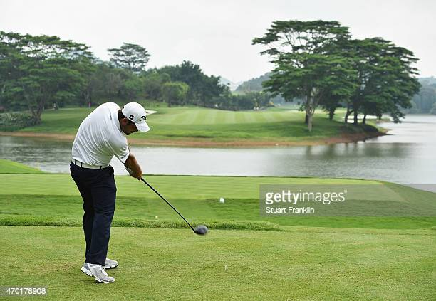 Alexander Levy of France plays a shot during the third round of the Shenzhen International at Genzon Golf Club on April 18 2015 in Shenzhen China