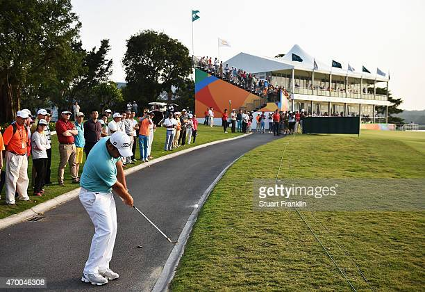 Alexander Levy of France plays a shot from the cart path on the 18th hole during the second round of the Shenzhen International at Genzon Golf Club...