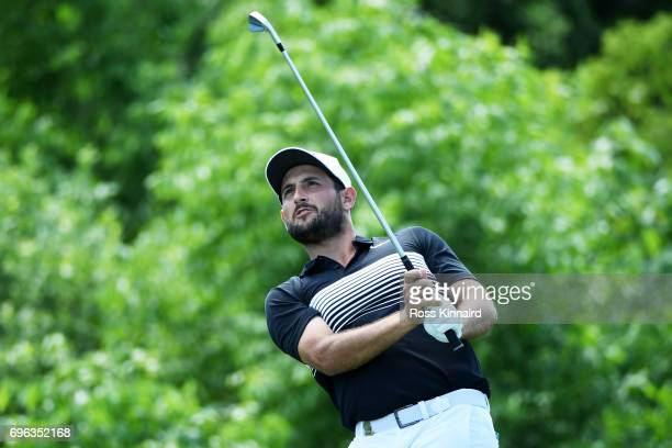 Alexander Levy of France plays his shot from the 16th tee during the first round of the 2017 US Open at Erin Hills on June 15 2017 in Hartford...