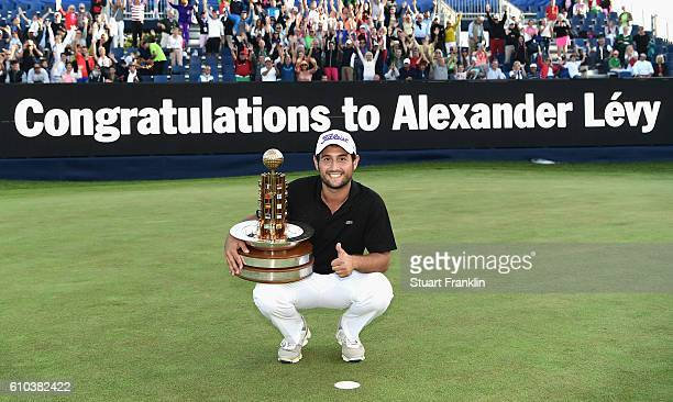Alexander Levy of France poses with the trophy after winning in the final round of the Porsche European Open at Golf Resort Bad Griesbach on...