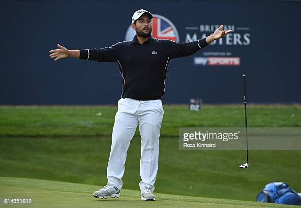 Alexander Levy of France reacts after an attempted eagle putt comes up short during the first round of the British Masters at The Grove on October 13...