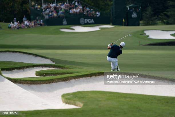 Alexander Levy of France reacts to his shot on the seventh hole during Round Two for the 99th PGA Championship held at Quail Hollow Club on August 11...
