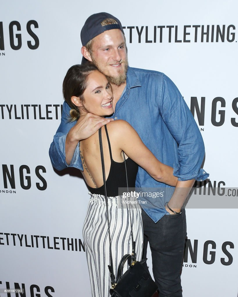 Alexander Ludwig and guest arrive at the TINGS 'Secret Party' launch party held at Nightingale on August 23, 2017 in West Hollywood, California.