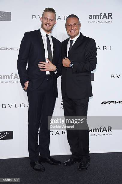 Alexander Ludwig and Jean Christophe Babin attends amfAR Milano 2014 as a part of Milan Fashion Week Womenswear Spring/Summer 2015 on September 20...