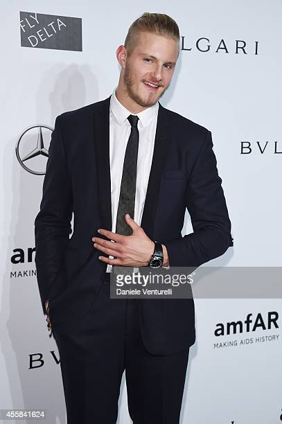 Alexander Ludwig attends amfAR Milano 2014 as a part of Milan Fashion Week Womenswear Spring/Summer 2015 on September 20 2014 in Milan Italy