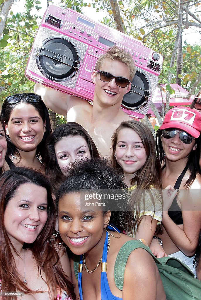 Alexander Ludwig poses backstage with fans at the Victoria's Secret PINK Ultimate Spring Break Dance Party in Miami at Raleigh Hotel on March 13, 2013 in Miami Beach, Florida.