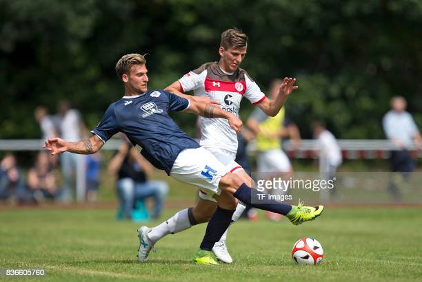 Alexander Luettmers of Oldenburg and Brian Koglin of St Pauli battle for the ball during the preseason friendly match between VfB Oldenburg and FC St...