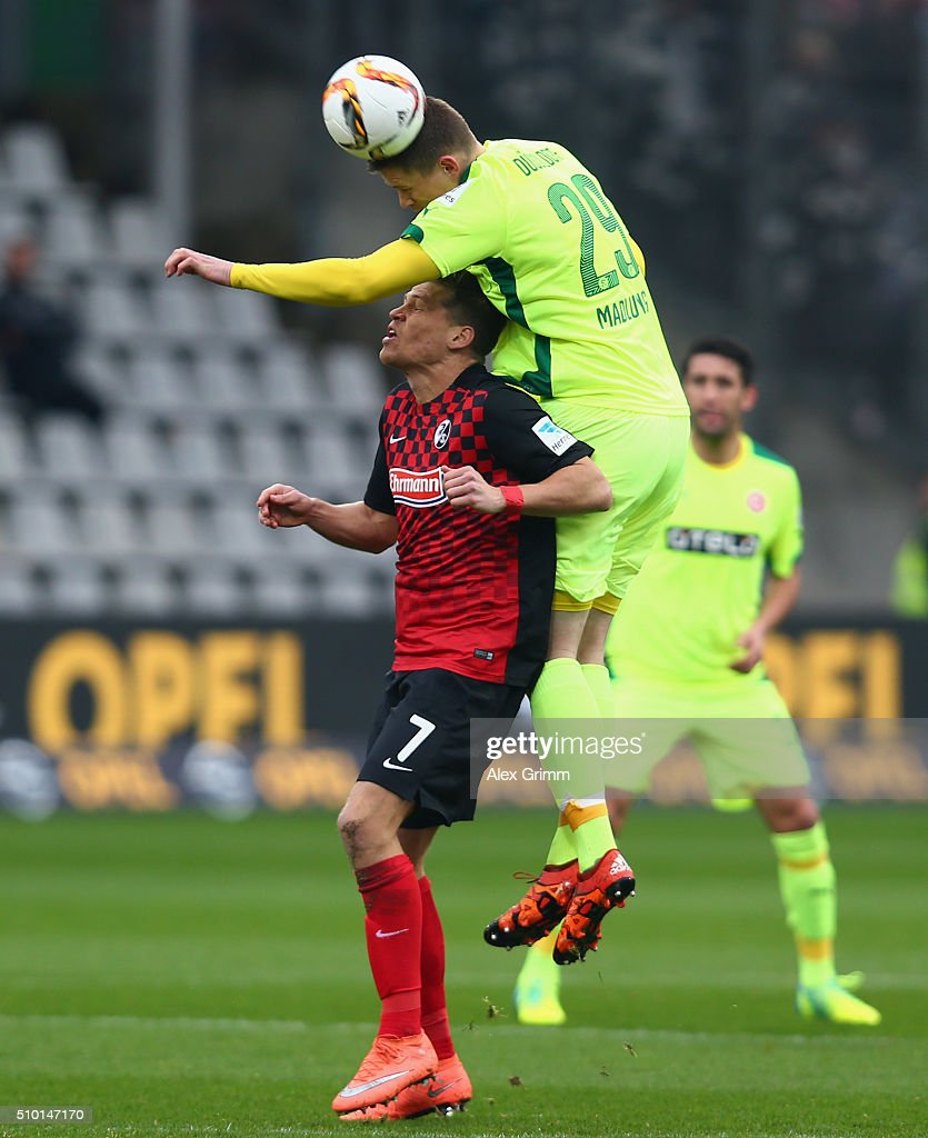<a gi-track='captionPersonalityLinkClicked' href=/galleries/search?phrase=Alexander+Madlung&family=editorial&specificpeople=645968 ng-click='$event.stopPropagation()'>Alexander Madlung</a> of Duesseldorf outjumps Florian Niederlechner of Freiburg during the Second Bundesliga match between SC Freiburg and Fortuna Duesseldorf at Schwarzwald-Stadion on February 14, 2016 in Freiburg im Breisgau, Germany.