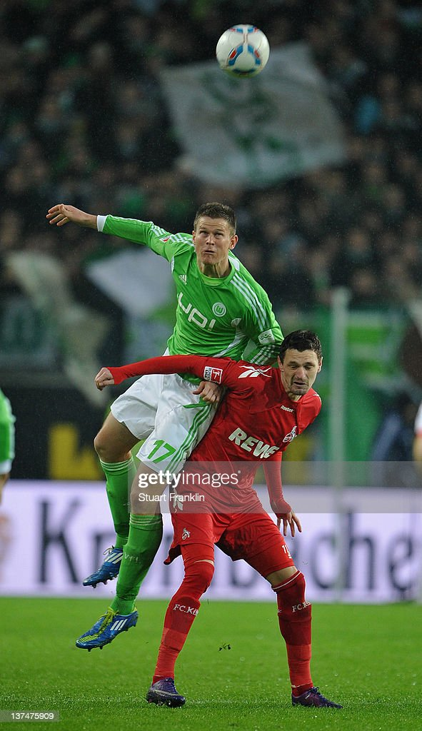 <a gi-track='captionPersonalityLinkClicked' href=/galleries/search?phrase=Alexander+Madlung&family=editorial&specificpeople=645968 ng-click='$event.stopPropagation()'>Alexander Madlung</a> of Wolfsburg is challenged by<a gi-track='captionPersonalityLinkClicked' href=/galleries/search?phrase=Milivoje+Novakovic&family=editorial&specificpeople=880645 ng-click='$event.stopPropagation()'>Milivoje Novakovic</a> of Koeln during the Bundesliga match between VfL Wolfsburg and 1. FC Koeln at Volkswagen Arena on January 21, 2012 in Wolfsburg, Germany.