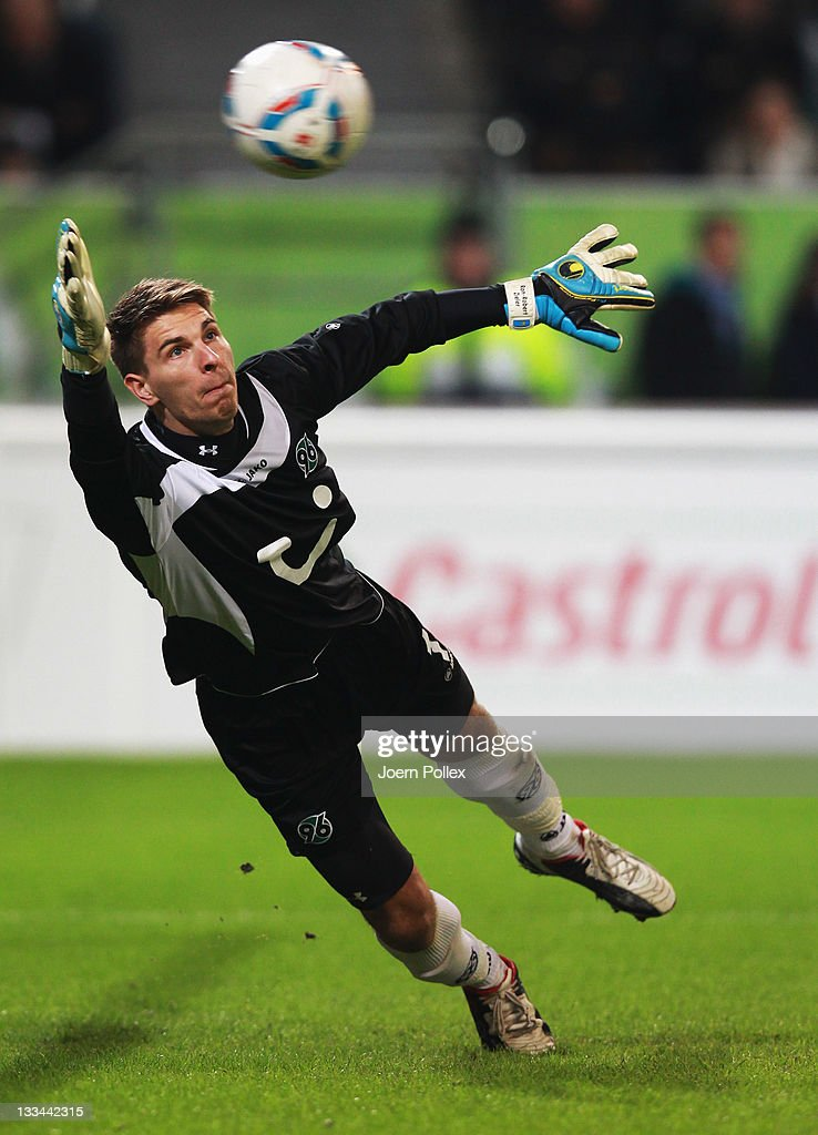 Alexander Madlung of Wolfsburg scores his team's fourth goal past goalkeeper RonRobert Zieler of Hannover during the Bundesliga match between VfL...