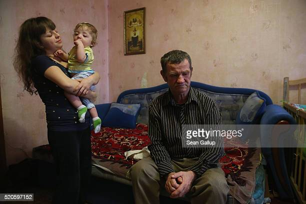 Alexander Malish a former Chernobyl 'liquidator' sits in the tworoom apartment he shares with his wife his daughter Anya and his grandson Nikita on...
