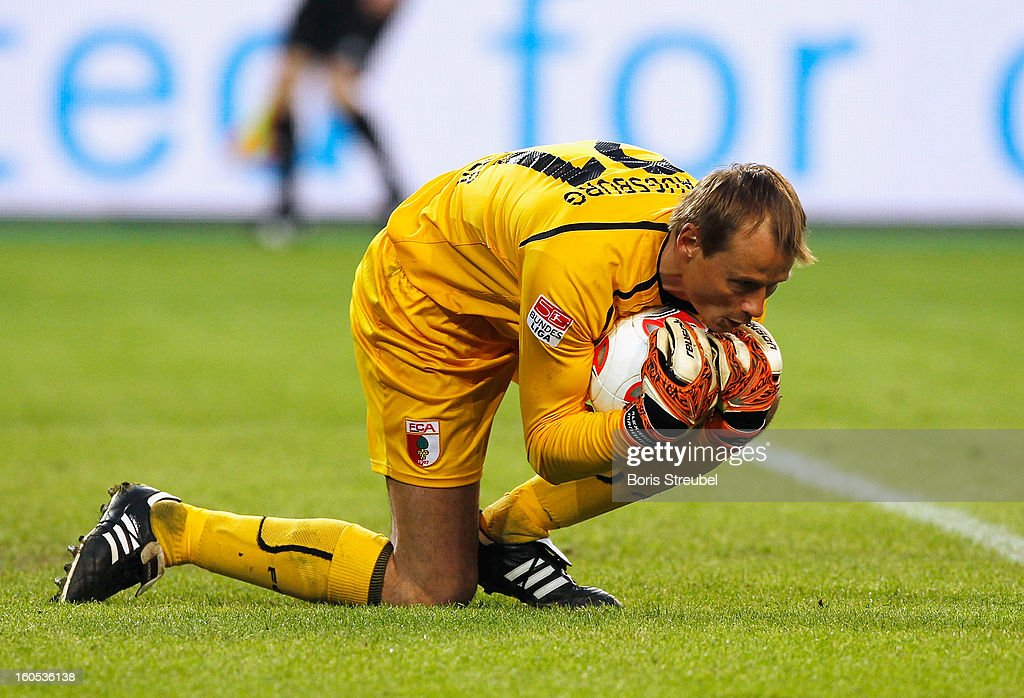 <a gi-track='captionPersonalityLinkClicked' href=/galleries/search?phrase=Alexander+Manninger&family=editorial&specificpeople=167082 ng-click='$event.stopPropagation()'>Alexander Manninger</a>, goalkeeper of Augsburg saves the ball during the Bundesliga match between VFL Wolfsburg and FC Augsburg at Volkswagen Arena on February 2, 2013 in Wolfsburg, Germany.