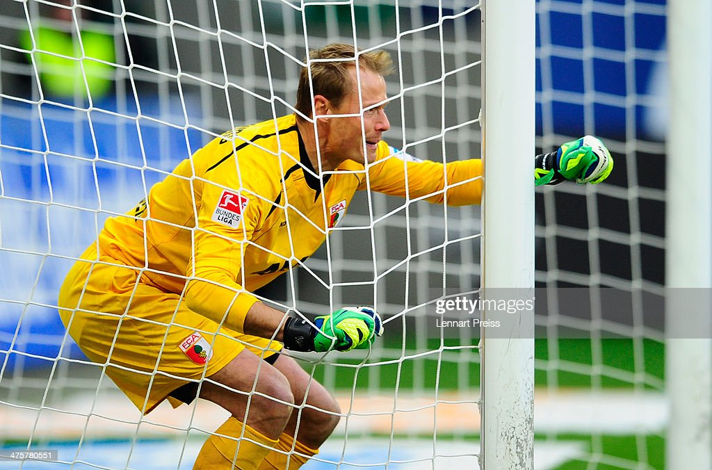 <a gi-track='captionPersonalityLinkClicked' href=/galleries/search?phrase=Alexander+Manninger&family=editorial&specificpeople=167082 ng-click='$event.stopPropagation()'>Alexander Manninger</a> of Augsburg reacts during the Bundesliga match between FC Augsburg and Hannover 96 at SGL Arena on March 1, 2014 in Augsburg, Germany.