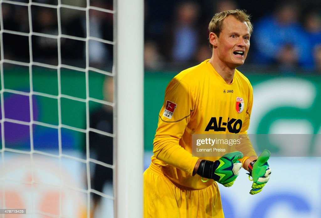 <a gi-track='captionPersonalityLinkClicked' href=/galleries/search?phrase=Alexander+Manninger&family=editorial&specificpeople=167082 ng-click='$event.stopPropagation()'>Alexander Manninger</a> of Augsburg reacts during the Bundesliga match between FC Augsburg and FC Schalke 04 at SGL Arena on March 14, 2014 in Augsburg, Germany.