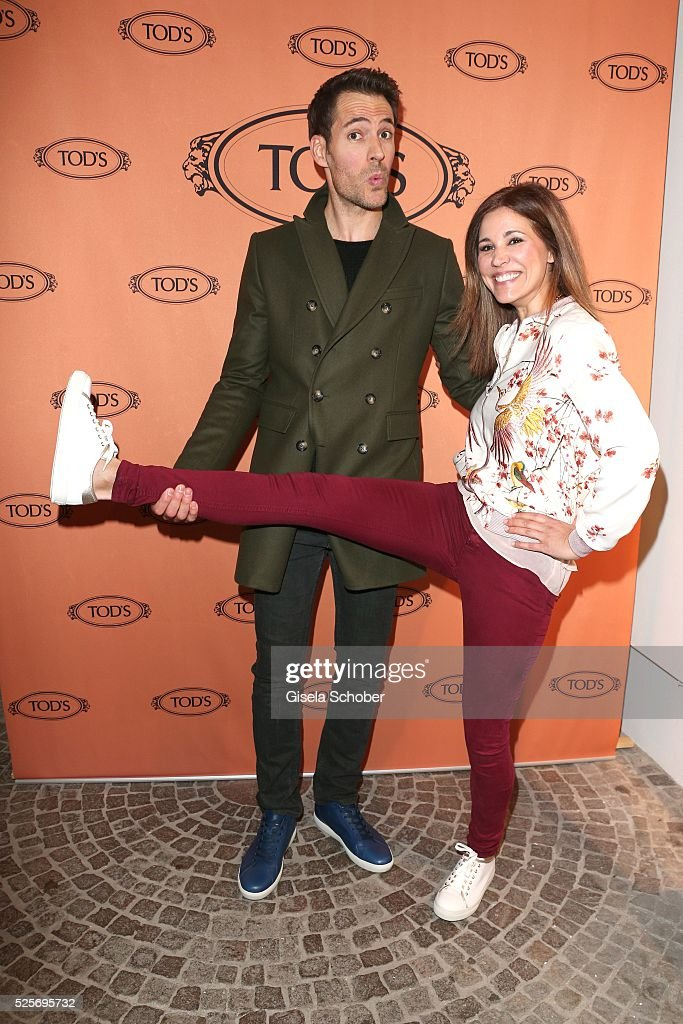Alexander Mazza and Karen Webb wearing Tod's shoes during the TOD'S 'The art of leather' party on April 28 2016 in Munich Germany