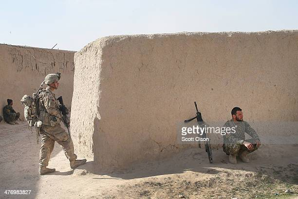 Alexander Medina from Keshena Wisconsin with the US Army's 4th squadron 2d Cavalry Regiment and a soldier with the Afghan National Army keep watch...