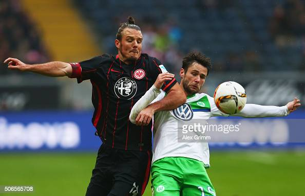 Alexander Meier of Eintracht Frankfurt and Christian Trasch of VfL Wolfsburg battle for the ball during the Bundesliga match between Eintracht...