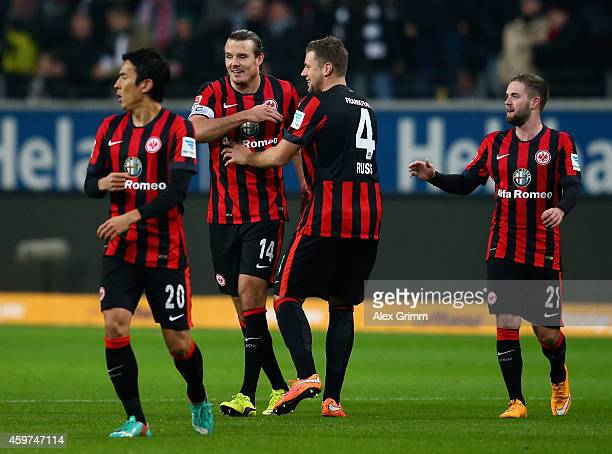 Alexander Meier of Eintracht Frankfurt celebrates with team mates as he scores his team's first goal during the Bundesliga match between Eintracht...