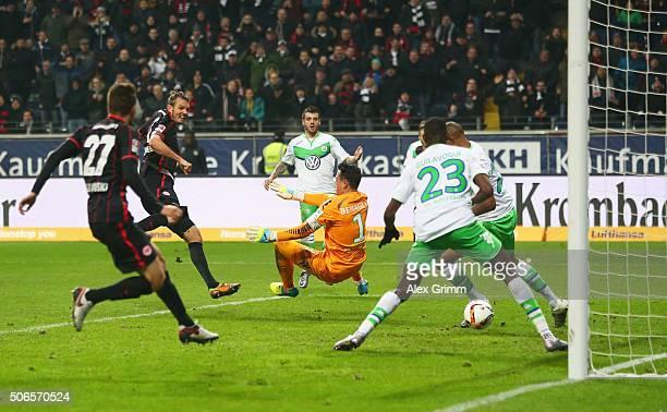 Alexander Meier of Eintracht Frankfurt shoots past goalkeeper Diego Benaglio of VfL Wolfsburg to score their third goal and complete his hat trick...