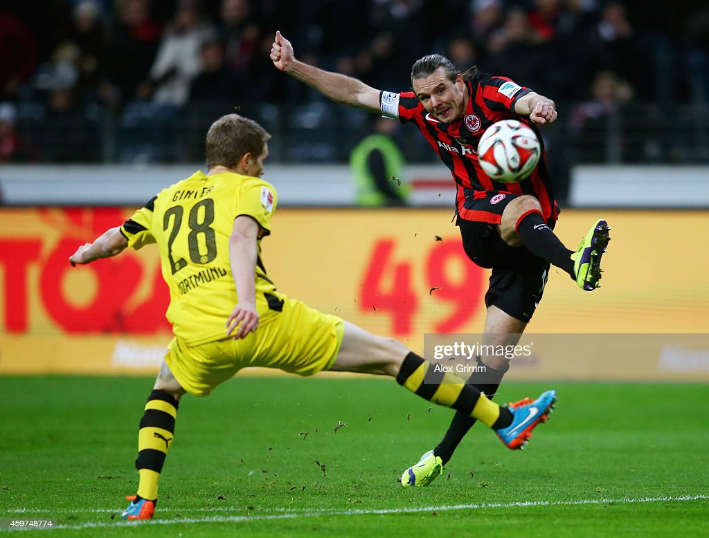 <a gi-track='captionPersonalityLinkClicked' href=/galleries/search?phrase=Alexander+Meier&family=editorial&specificpeople=615512 ng-click='$event.stopPropagation()'>Alexander Meier</a> of Eintracht Frankfurt takes a shot past <a gi-track='captionPersonalityLinkClicked' href=/galleries/search?phrase=Matthias+Ginter&family=editorial&specificpeople=8616925 ng-click='$event.stopPropagation()'>Matthias Ginter</a> of Borussia Dortmund during the Bundesliga match between Eintracht Frankfurt and Borussia Dortmund at Commerzbank-Arena on November 30, 2014 in Frankfurt am Main, Germany.
