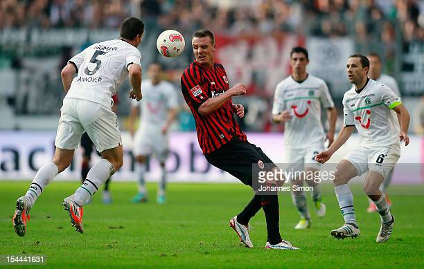 Alexander Meier of Frankfurt and Mario Eggimann of Hannover fight for the ball during the Bundesliga match between Eintracht Frankfurt and Hannover...