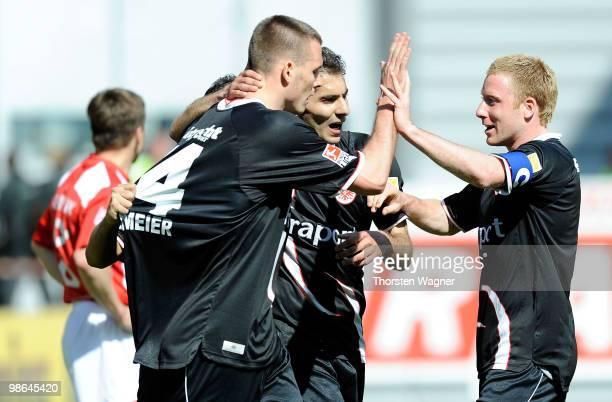 Alexander Meier of Frankfurt celebrates after scoring the 10 with his team mates Halil Altintop and Patrick Ochs during the Bundesliga match between...