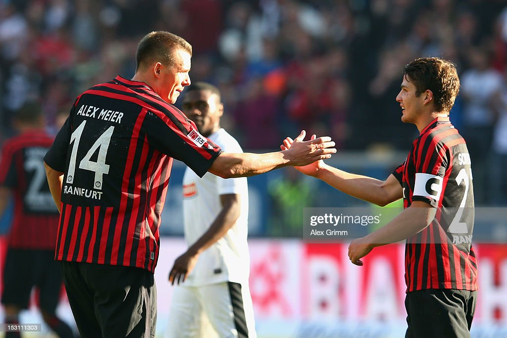 <a gi-track='captionPersonalityLinkClicked' href=/galleries/search?phrase=Alexander+Meier&family=editorial&specificpeople=615512 ng-click='$event.stopPropagation()'>Alexander Meier</a> (L) of Frankfurt celebrates his team's first goal with team mate <a gi-track='captionPersonalityLinkClicked' href=/galleries/search?phrase=Pirmin+Schwegler&family=editorial&specificpeople=604263 ng-click='$event.stopPropagation()'>Pirmin Schwegler</a> during the Bundesliga match between Eintracht Frankfurt and SC Freiburg at Commerzbank-Arena on September 30, 2012 in Frankfurt am Main, Germany.