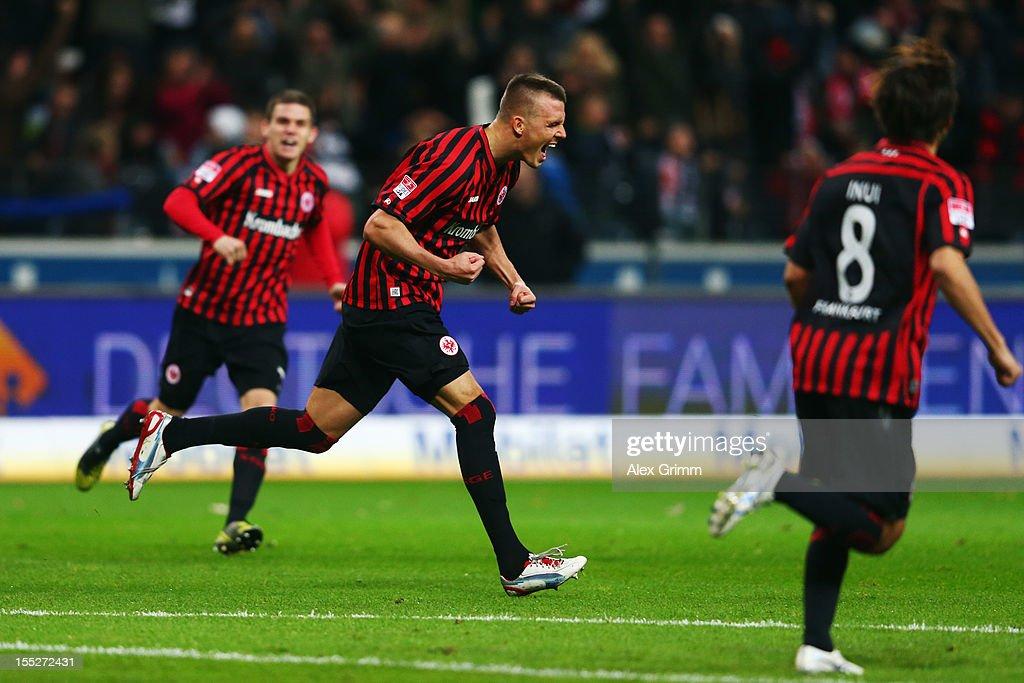 Alexander Meier of Frankfurt celebrates his team's first goal with team mates Sebastian Jung and Takashi Inui during the Bundesliga match between...