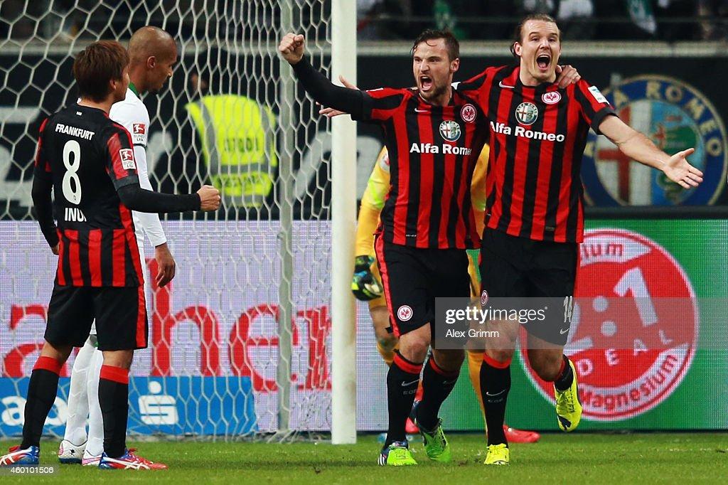 Alexander Meier of Frankfurt celebrates his team's first goal with team mates Haris Seferovic and Takashi Inui during the Bundesliga match between...