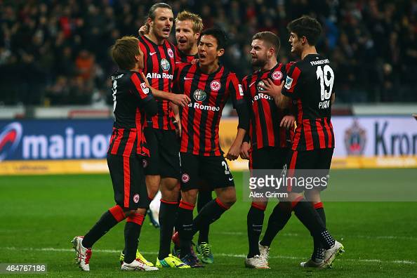 Alexander Meier of Frankfurt celebrates his team's first goal with team mates during the Bundesliga match between Eintracht Frankfurt and Hamburger...