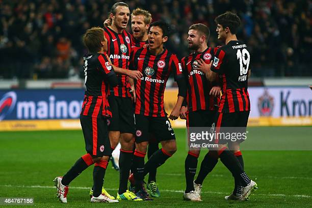Alexander Meier of Frankfurt celebrates his team's first goal with team mates during the Bundesliga match between Eintracht Frankfurt and Hamburger...