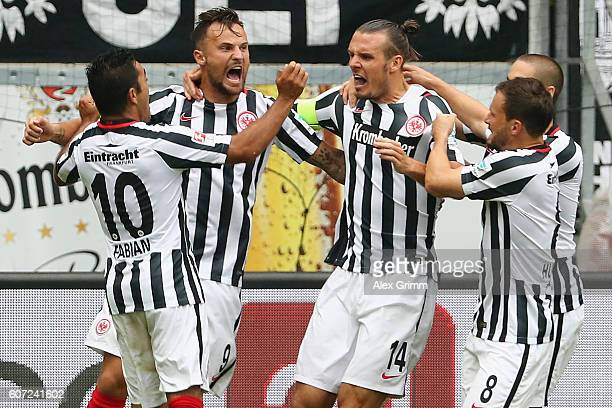 Alexander Meier of Frankfurt celebrates his team's first goal with team mates during the Bundesliga match between Eintracht Frankfurt and Bayer 04...