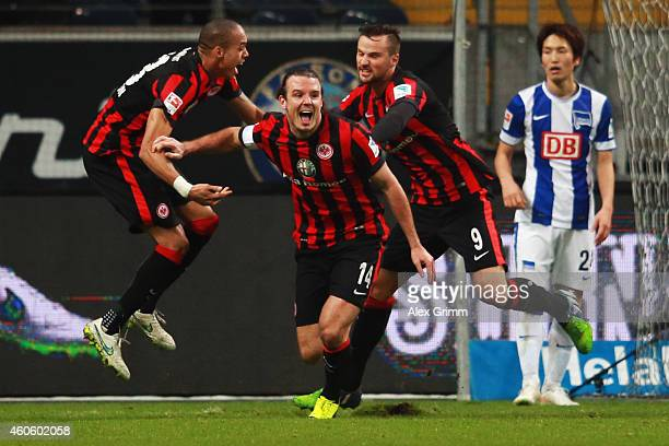 Alexander Meier of Frankfurt celebrates his team's fourth goal with team mates Bamba Anderson and Haris Seferovic during the Bundesliga match between...