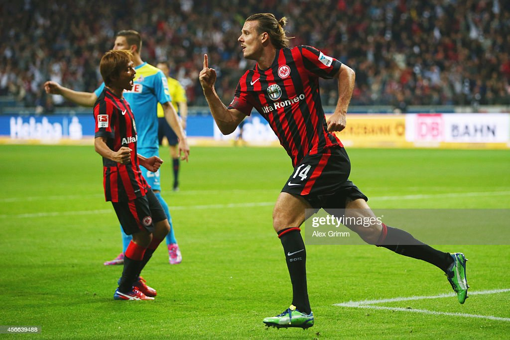<a gi-track='captionPersonalityLinkClicked' href=/galleries/search?phrase=Alexander+Meier&family=editorial&specificpeople=615512 ng-click='$event.stopPropagation()'>Alexander Meier</a> of Frankfurt celebrates his team's second goal during the Bundesliga match between Eintracht Frankfurt and 1. FC Koeln at Commerzbank-Arena on October 4, 2014 in Frankfurt am Main, Germany.