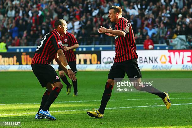 Alexander Meier of Frankfurt celebrates his team's second goal with team mate Bamba Anderson during the Bundesliga match between Eintracht Frankfurt...