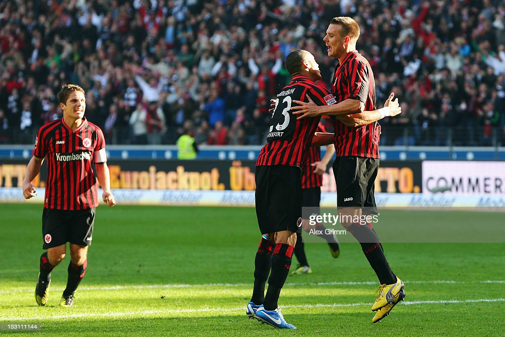 <a gi-track='captionPersonalityLinkClicked' href=/galleries/search?phrase=Alexander+Meier&family=editorial&specificpeople=615512 ng-click='$event.stopPropagation()'>Alexander Meier</a> of Frankfurt celebrates his team's second goal with team mates Bamba Anderson and <a gi-track='captionPersonalityLinkClicked' href=/galleries/search?phrase=Pirmin+Schwegler&family=editorial&specificpeople=604263 ng-click='$event.stopPropagation()'>Pirmin Schwegler</a> (R-L) during the Bundesliga match between Eintracht Frankfurt and SC Freiburg at Commerzbank-Arena on September 30, 2012 in Frankfurt am Main, Germany.