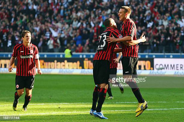 Alexander Meier of Frankfurt celebrates his team's second goal with team mates Bamba Anderson and Pirmin Schwegler during the Bundesliga match...