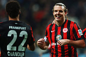 Alexander Meier of Frankfurt celebrates his team's third goal with team mate Timothy Chandler during the Bundesliga match between Eintracht Frankfurt...