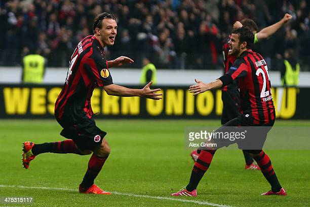 Alexander Meier of Frankfurt celebrates his team's third goal with team mate Tranquillo Barnetta during the UEFA Europa League Round of 32 second leg...