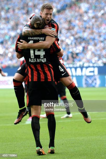 Alexander Meier of Frankfurt celebrates with team mate Marco Russ after scoring the opening goal during the Bundesliga match between FC Schalke 04...