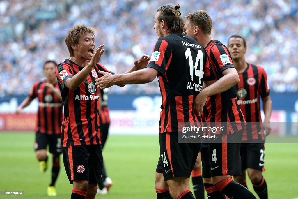 <a gi-track='captionPersonalityLinkClicked' href=/galleries/search?phrase=Alexander+Meier&family=editorial&specificpeople=615512 ng-click='$event.stopPropagation()'>Alexander Meier</a> (C) of Frankfurt celebrates with team mate <a gi-track='captionPersonalityLinkClicked' href=/galleries/search?phrase=Takashi+Inui&family=editorial&specificpeople=7174976 ng-click='$event.stopPropagation()'>Takashi Inui</a> (L) after scoring the opening goal during the Bundesliga match between FC Schalke 04 and Eintracht Frankfurt at Veltins Arena on September 20, 2014 in Gelsenkirchen, Germany.