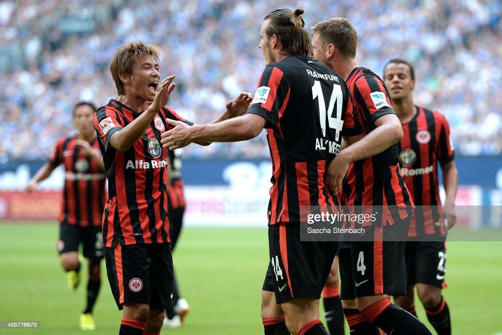 Alexander Meier of Frankfurt celebrates with team mate Takashi Inui after scoring the opening goal during the Bundesliga match between FC Schalke 04...