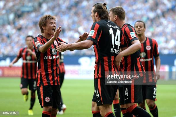 Alexander Meier of Frankfurt celebrates with team mate Takashi Inui after scoring the opening goal during the Bundesliga match between FC Schalke 04...