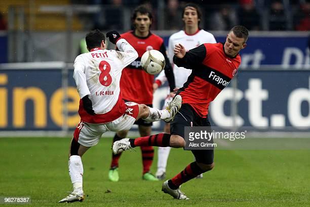 Alexander Meier of Frankfurt is challenged by Petit of Koeln during the Bundesliga match between Eintracht Frankfurt and 1 FC Koeln at the...